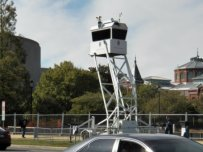 And of course, the ubiquitous surveillance tower, seen soon in a city near you