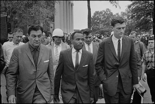 Chief U.S. Marshal James McShane (left) and Assistant Attorney General for Civil Rights, John Doar (right) of the Justice Department, escorting James Meredith to class at Ole Miss.